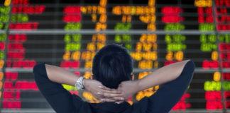 backshot of a woman looking at stocks