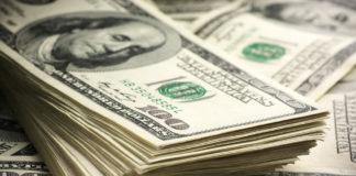 Dollar bills stacked on top of more dollar bills