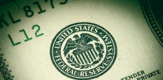 Federal reserve seal on dollar bill