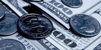 Dollar bills and coins close up shot