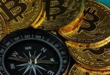 Bitcoins grouped around a compass