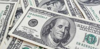 dollar bills piled up
