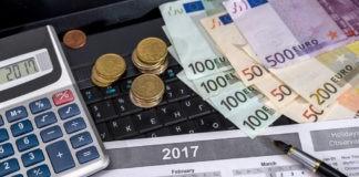wibest - euro banknotes splayed on keyboard