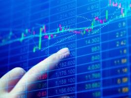 Wibest Broker-Share Market News: Closeup shot of a finger pointing at graphs on stock market chart